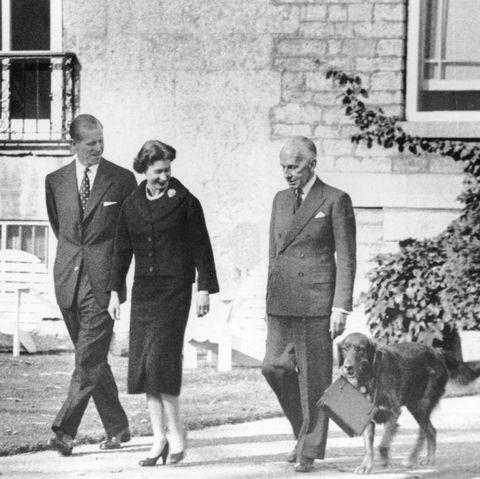 queen elizabeth vincent massey dog carrying purse