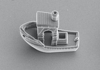 3d benchy, a tiny 3d printed boat that is about 13 the size of a strand of hair