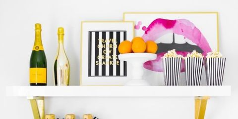 Shelf, Wine bottle, Product, Yellow, Wall, Shelving, Furniture, Bottle, Font, Design,