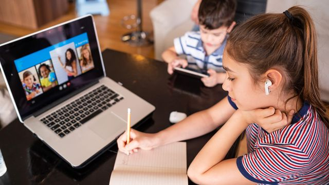 teenage girl studying with video online lesson at home   family in isolation covid 19 homeschooling and distance learning