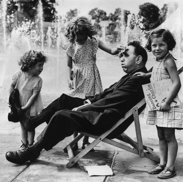 6th august 1951  the three little robson girls, hazel, beryl and ruth, minister to their tired father, taking off his shoes, mopping sweat from his brow and bringing him games and books  photo by fox photosgetty images