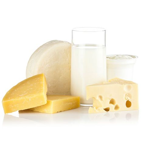 dairy products, including a glass of milk and various cheeses
