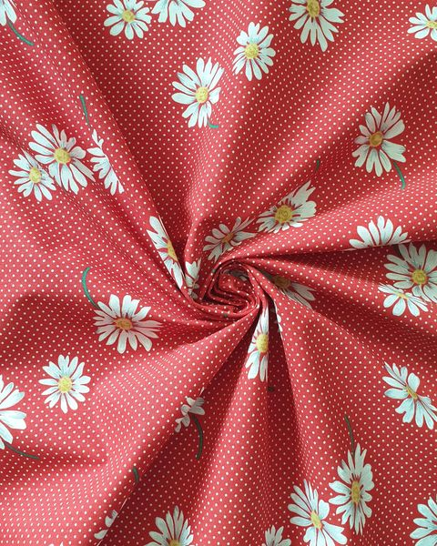 red dotted daisy print fabric