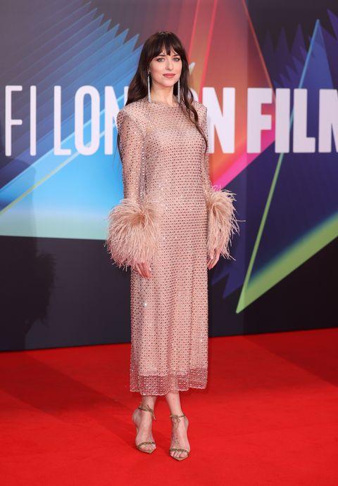 Dakota Johnson on the red carpet of the lost daughter