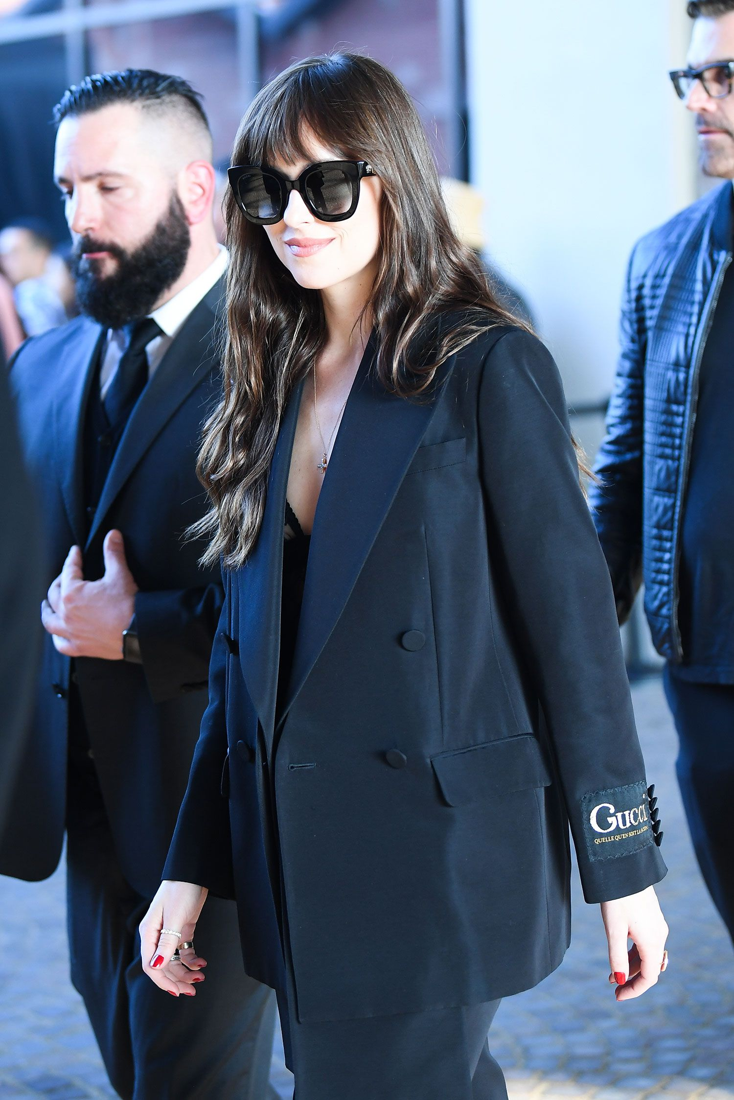 Dakota Johnson Pairs Lingerie With a Gucci Suit for Chic Milan Fashion Week Look