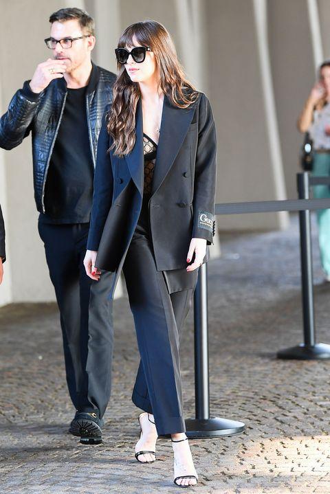 Dakota Johnson Wore Gucci Lingerie and a Suit at Milan Fashion Week