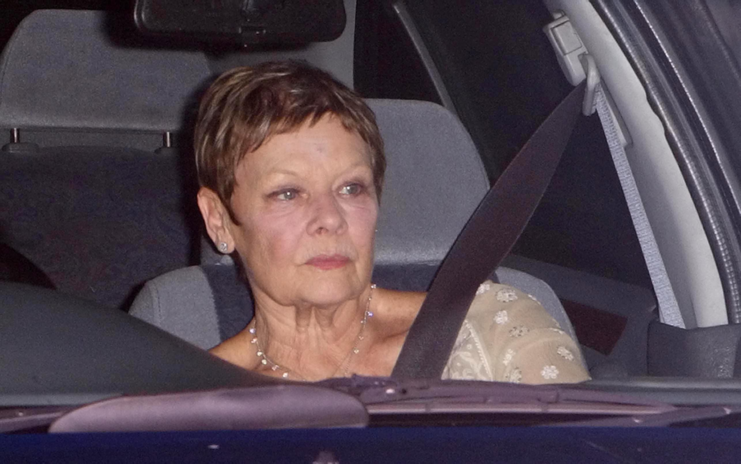 Dame Judi Dench arrives at the party.