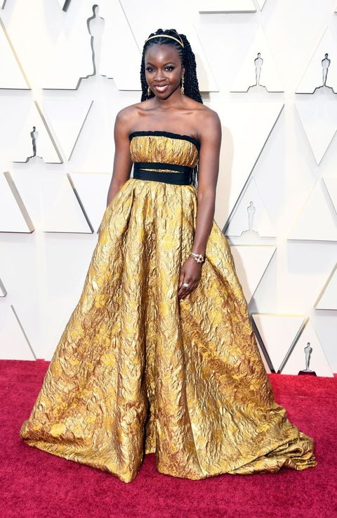 Dress, Clothing, Red carpet, Carpet, Gown, Fashion model, Yellow, Strapless dress, Flooring, Fashion,