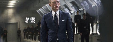 Suit, Formal wear, White-collar worker, Tuxedo, Standing, Blazer, Snapshot, Outerwear, Businessperson, Bodyguard,