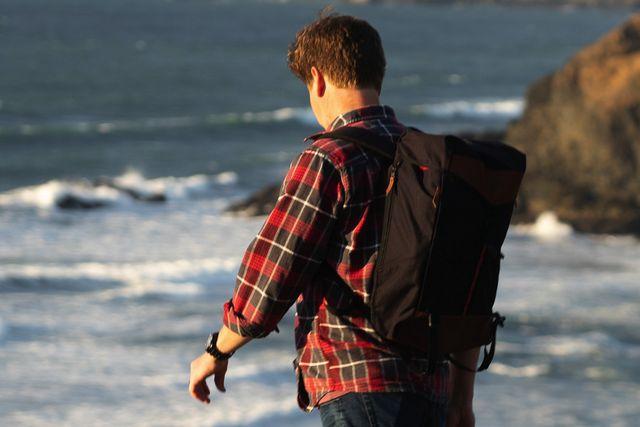 a man hiking near the ocean
