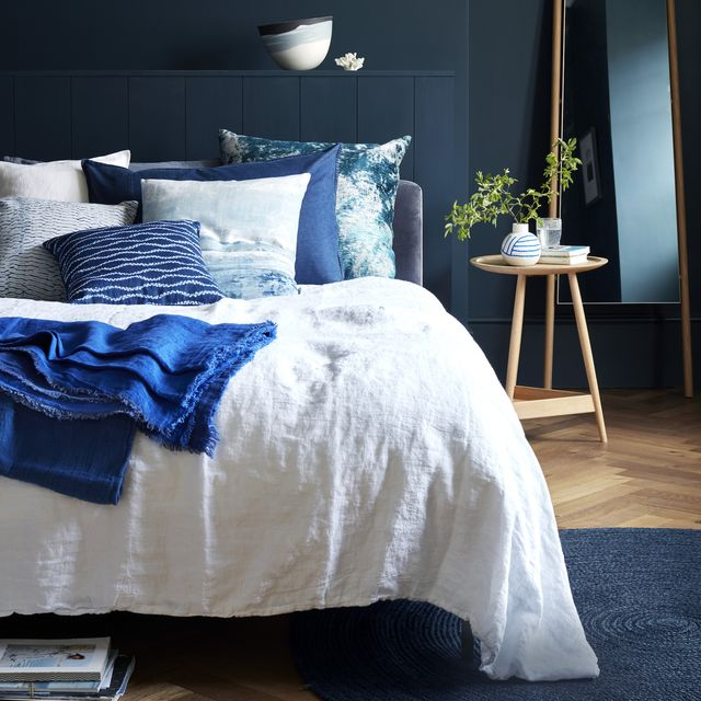 into the blue choose a breezy coastal inspired palette that ranges from calming cobalt to inky azure, tocreate a cool, comfortable look image shows a bedroom walls, as left chrome bed, £1,155,loaf cushions l r brera lino alabaster,£60, designers guild indigo, £95,baileys home kensu viridian, £145,black edition indigo shibori mokumecover, £75, ecosophy perfect day, £86,black edition wave shibori, £65, toastheavy linen throw in indigo, £145,toast vice versa linen throw in cobalt,£275 bud vase, £75 etienne tumbler,£12 all the conran shop stresa biancoduvet cover, £220, designers guildeden leaning mirror, £379 jute rug,£159 both heal's clyde side table,£715, pinch blue cosmos vessel,£530, alison gautrey at jaggedartfaux coral plinth not shown, £75 fortwo, the big blue company