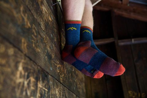 Sock, Wool, Red, Leg, Ankle, Human leg, Footwear, Fashion accessory, Joint, Knitting,