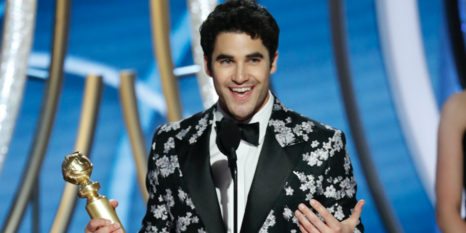 """Darren Criss from """"The Assassination of Gianni Versace: American Crime Story"""" accepts the Best Performance by an Actor in a Limited Series or Motion Picture Made for Television award onstage during the 76th Annual Golden Globe Awards"""