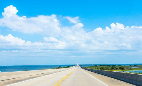 Sky, Road, Blue, Daytime, Horizon, Natural landscape, Cloud, Highway, Sea, Natural environment,