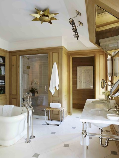 a white marble and wood master bathroom