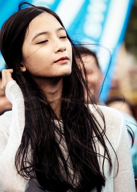 Hair, Face, White, Beauty, Lip, Skin, Blue, Long hair, Hairstyle, Nose,