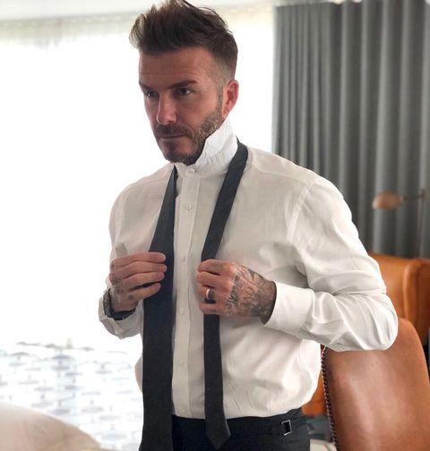 White, Suit, Clothing, Tie, Formal wear, Dress shirt, Outerwear, Tuxedo, Collar, Blazer,