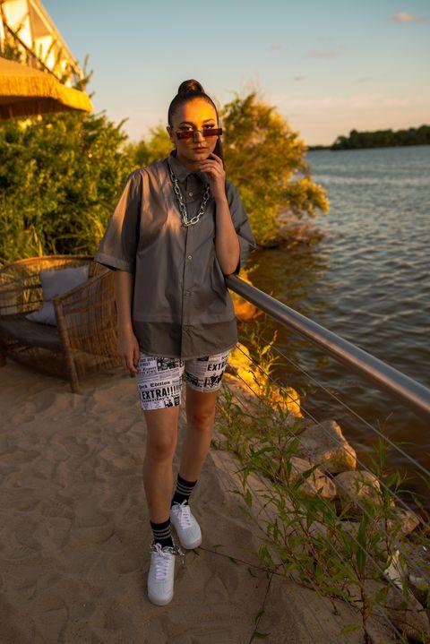 Yellow, Fashion, Summer, Footwear, Vacation, Photography, Shorts, Street fashion, Sunglasses, Shoe,