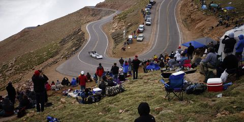 Crowd, Mountain pass, Vehicle, Mountain, Recreation, Adventure, Tourism, Mountain range, Road, Leisure,