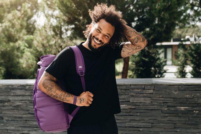db bags man wearing purple backpack