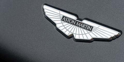 Vehicle, Car, Badge, Emblem, Aston martin lagonda, Logo, Trademark, Grille, Symbol,