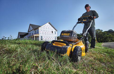 Vehicle, Lawn, Grass, Mower, Lawn mower, Grassland, Outdoor power equipment, Riding mower, Sky, Soil,