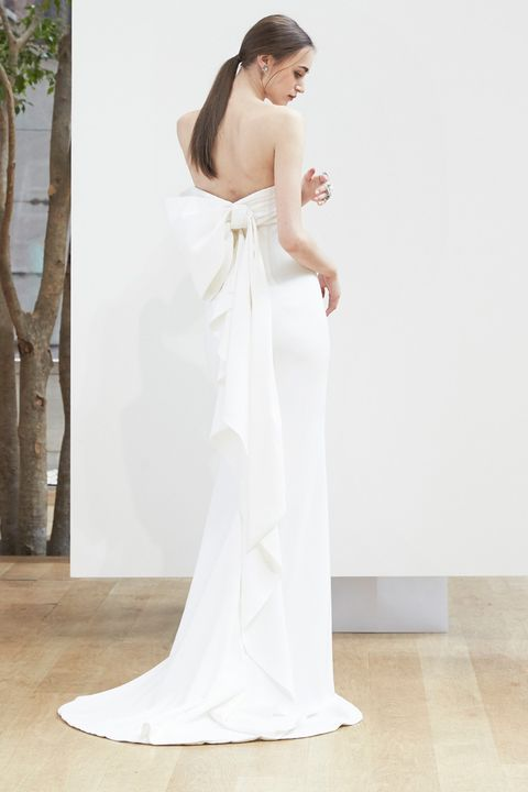 Clothing, Human body, Shoulder, Dress, Bridal clothing, Floor, Joint, Elbow, Gown, Wedding dress,
