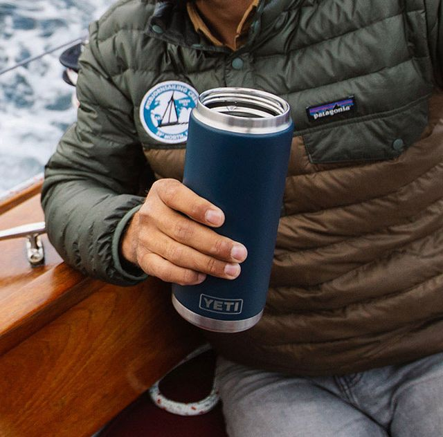 man sailing with yeti rambler