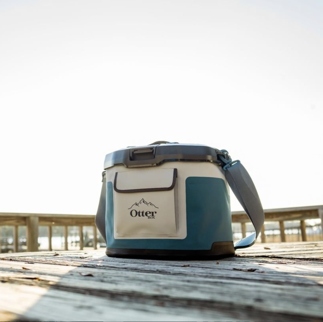 a soft cooler on a picnic table