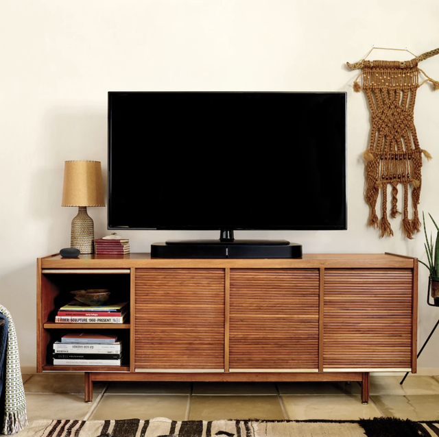 a home theater system on a desk in a living room