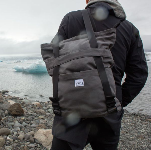 a model with a backpack near icebergs