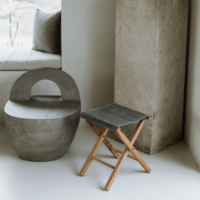 a camp stool and other furniture