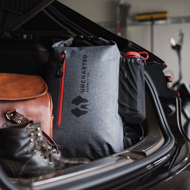 a survival bag in the back of a car