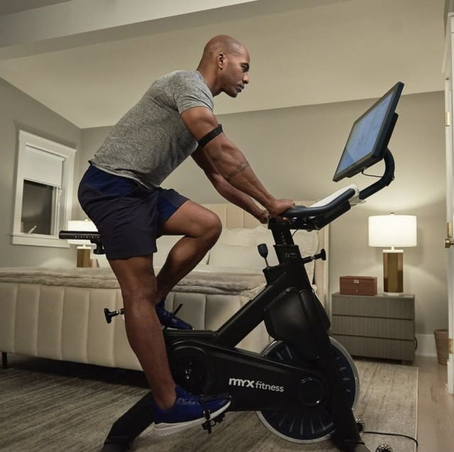 a model using an exercise bike