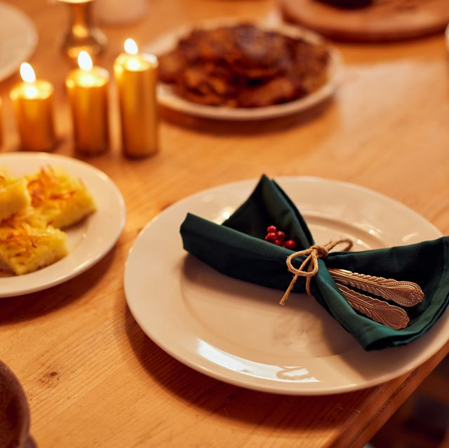 decorated dining table with traditional jewish food for hanukkah