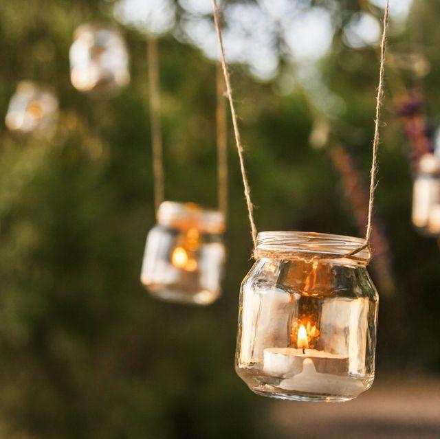 Mason jar, Lantern, Lighting, Light, Tree, Branch, Drinkware, Sky, Glass, Room,