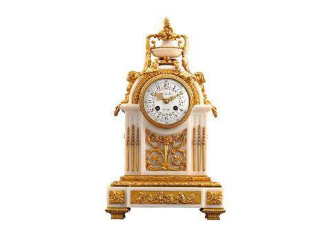 Orologio vintage in stile Luigi XVI. Il resto nel testo.