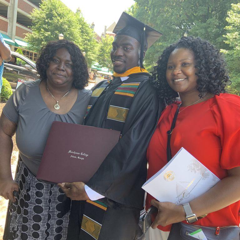 Davis-Correia with his aunts Kimberly (left) and Ebony (right).