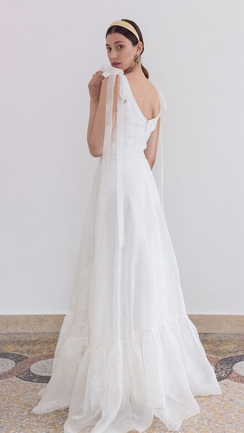 Gown, Wedding dress, Clothing, Dress, Bridal clothing, Fashion model, Shoulder, Bridal party dress, Bridal accessory, A-line,