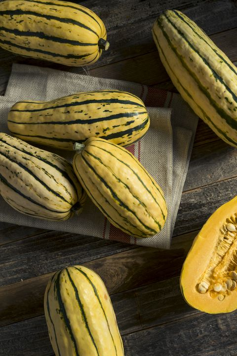 Delicata Squash on wood background with burlap