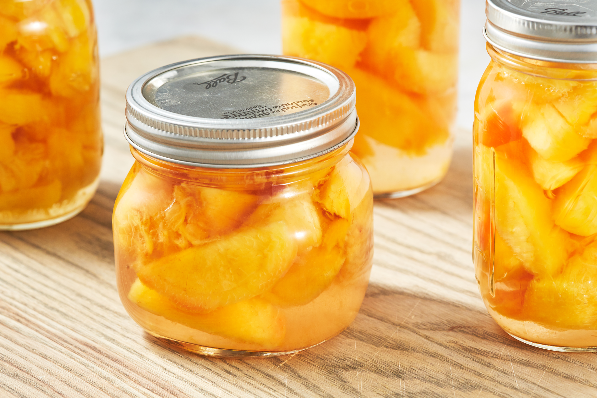 https://hips.hearstapps.com/hmg-prod.s3.amazonaws.com/images/delish-190618-how-to-can-peaches-339-landscape-pf-1561585080.png
