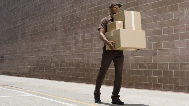 delivery person carrying boxes