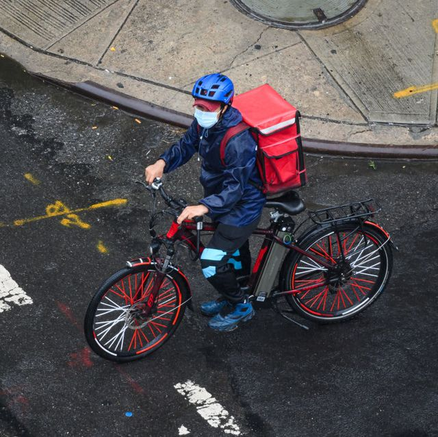 a food delivery cyclist on an e bike in new york city
