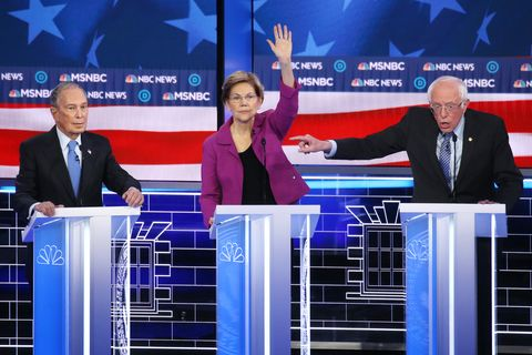 Democratic presidential candidate Sen. Bernie Sanders (I-VT) (R) gestures as Sen. Elizabeth Warren (D-MA) and former New Yor