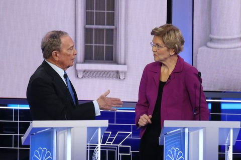 Democratic presidential candidates (L-R) former New York City Mayor Mike Bloomberg and Sen. Elizabeth Warren (D-MA) speak du