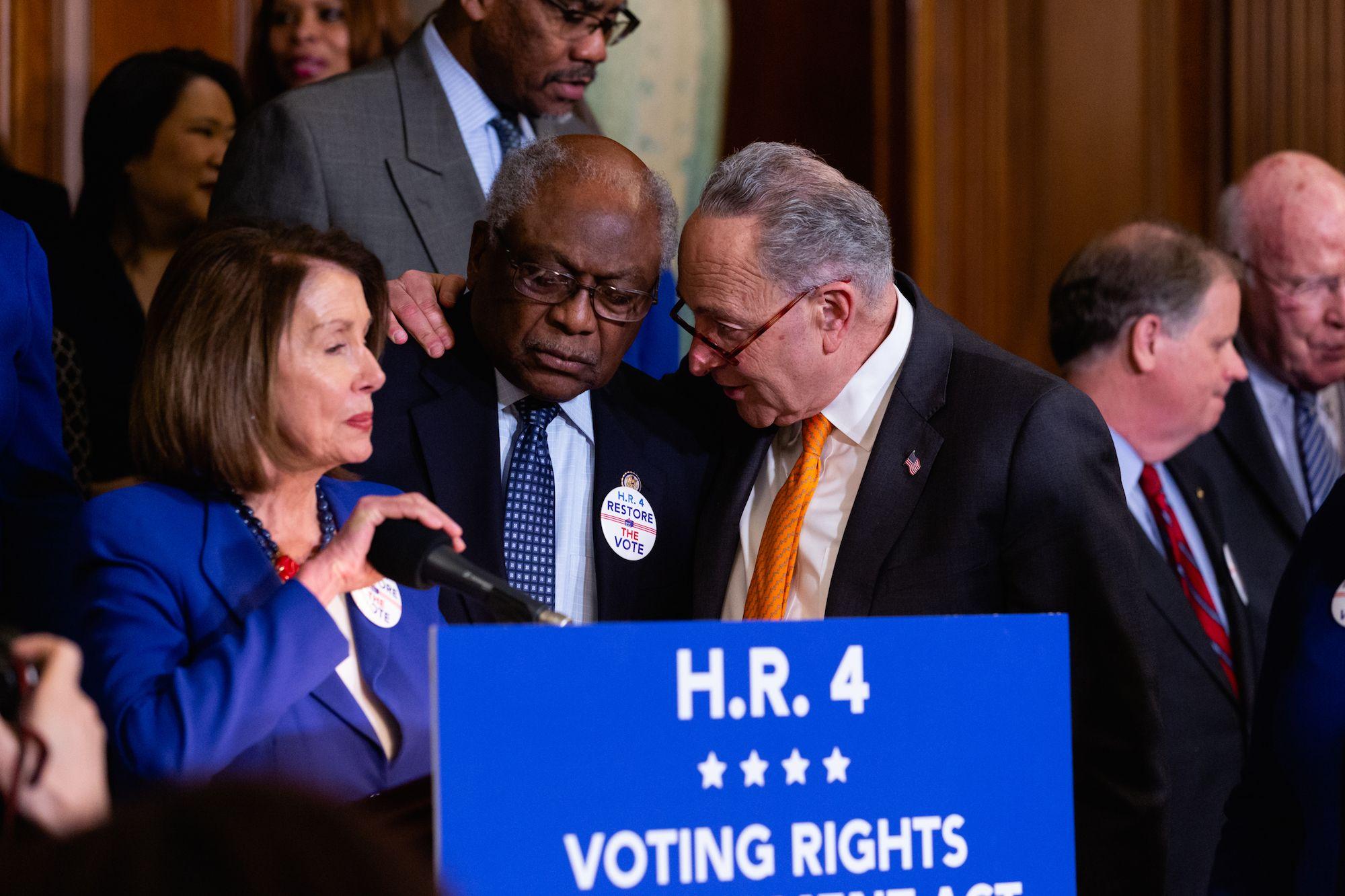 Pelosi with House Democratic Whip Jim Clyburn (C) and Senate Minority Leader Chuck Schumer (R