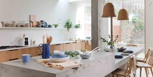 Denby have teamed up with designers, 2LG Studios, to reveal a mindful kitchen featuring the calming tones of new hand-crafted Studio Blue stoneware.