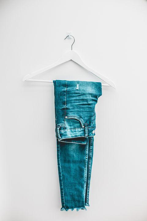 denim jeans on hanger
