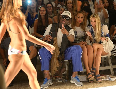 dennis rodman anna kosturovabeach riotlolli swimmanglarindah at mercedes benz fashion week swim 2014   front row