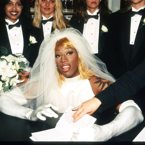 dennis rodman signs his autobiography august 21, 1996 in new york city rodman arrived in a horse drawn carriage dressed in a wedding gown to launch his new book called bad as i wanna be photo by evan agostiniliaison